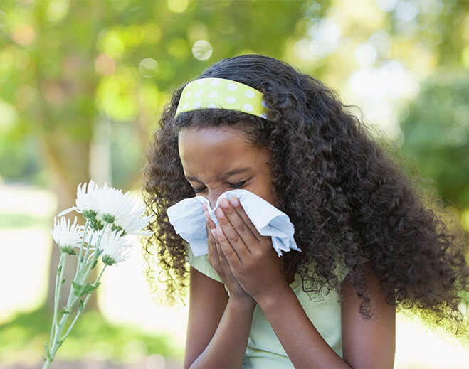 Child Sneezing with Allergies