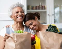 Mom and Daughter holding groceries