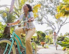 Happy Mature woman riding a bike